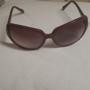 Fossill sunglasses. Maroonish /purple
